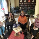These friends enjoy sitting around the fireplace to chat before dinner... almost nightly! It's always more fun when there are hats involved.