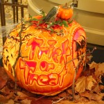 This was the winning pumpkin! (The two pictures following this one are the same pumpkin.) It was carved on every side, painted, had a light inside, and was on a turntable so you could see every side.