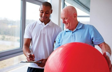 Senior Man Working with a Personal Trainer