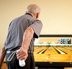 resident enjoying a game of Wii bowling
