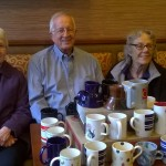 A few of our residents with the mugs that were donated!