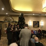 Holiday Harmony Carolers entertaining in the Living Room