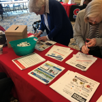 AARP was a popular table (and presentation). Echo and Martha were signing up for a raffle basket!