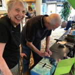 Jan and Paul sign up for one of the many Pacific Regent-donated raffle baskets! (Paul in fact won an orchid in a NY Life raffle!)
